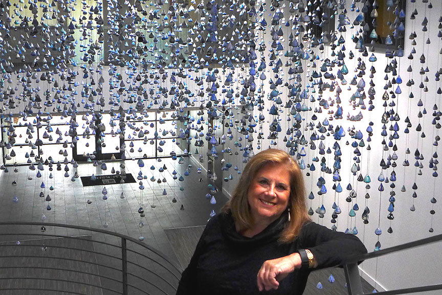 Stephanie with installation of over 5,000 ceramic elements, Drop By Drop.